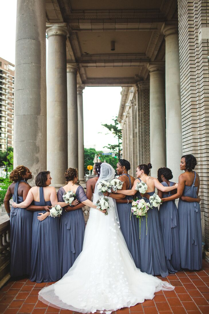 """""""I wanted the bridesmaid dresses to fit their personalities but still have an overall sense of uniformity,"""" says Rachel, who selected a gray chiffon dress from David's Bridal that had a variety of styles. """"We added a crystal sash, their earrings were gifts from me, and each sported braids or curls to match my style."""""""