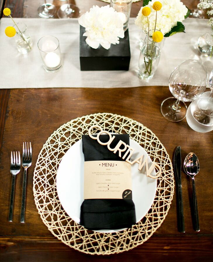 """Instead of classic charger plates and place cards, Danielle and David decked out their tables with webbed wooden placemats and laser cut wooden name tags to mark each guest's seat, striking the ultimate balance of rustic and modern aesthetics. """"Everyone loved feeling like they were an important part of our special day, which, of course, they were, and folks tell us that they still have their names prominently displayed at home or work,"""" says Danielle."""