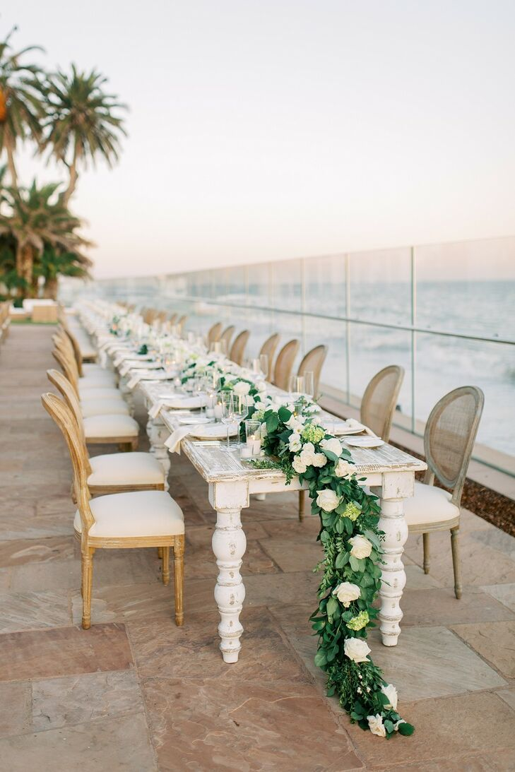 Intimate Waterfront Dining Table with Greenery Garland Centerpiece
