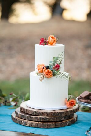 Simple White Wedding Cake With Orange and Red Flowers