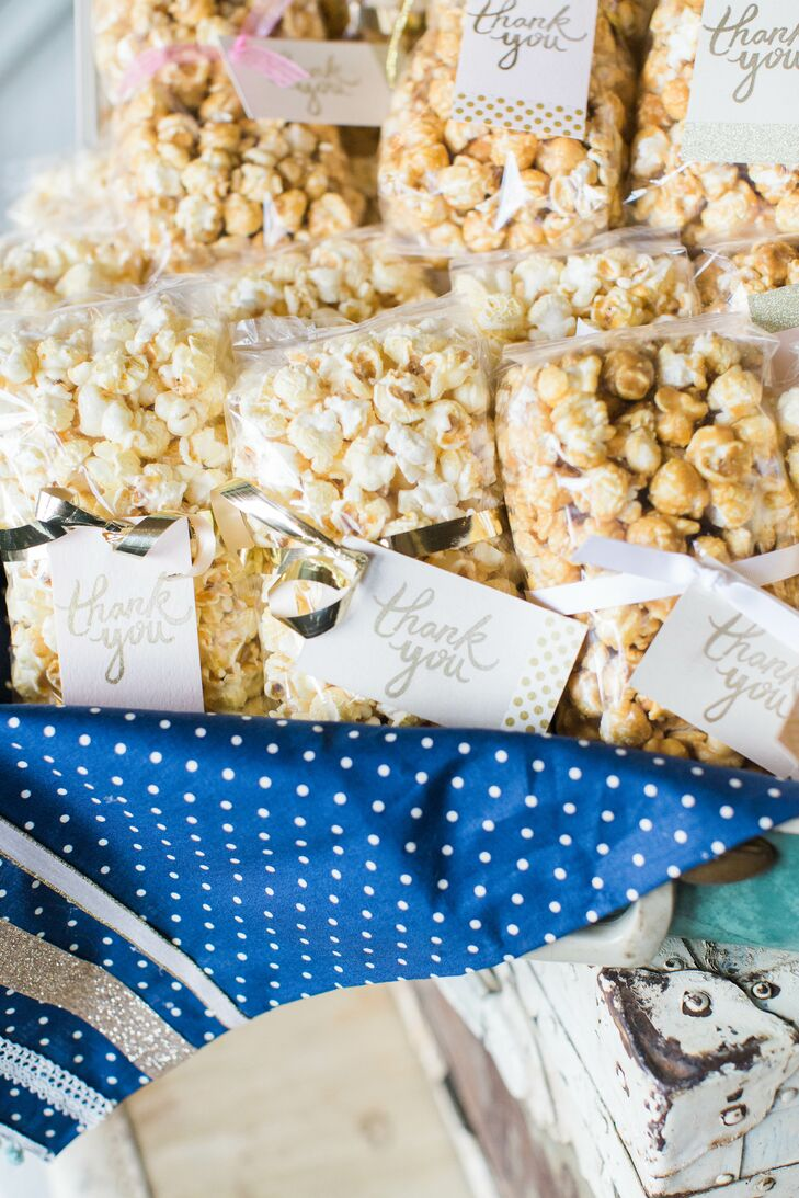 As a wedding favor, Jordan and Katelyn gave each guest the option of taking a bag of Kettle Corn or Caramel Corn made by Dorothy and Tony's Gourmet Specialties.Each bag was tied with a ribbon and a handwritten 'Thank You'.