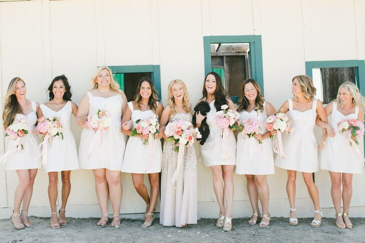 Audrey stood out wearing her champagne-colored dress accented with gold sequins next to the bridesmaids, who wore the traditional white wedding-dress color. The bridesmaids picked out their style choice of knee-length dresses.