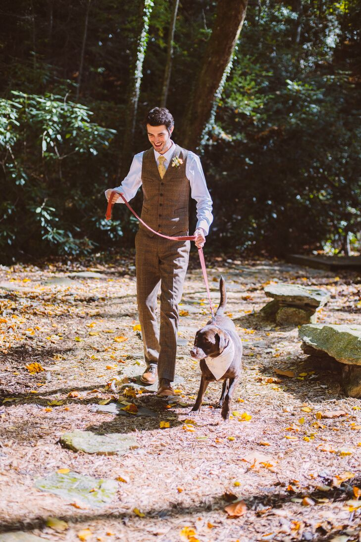 Sarah and Daniel's wedding was truly an intimate family affair. In addition to Sarah's daughter Bailey, the couple took along their 12-year-old chocolate lab, Kenzie, to North Carolina. Kenzie took part in the wedding festivities, accompanying Daniel down the aisle.