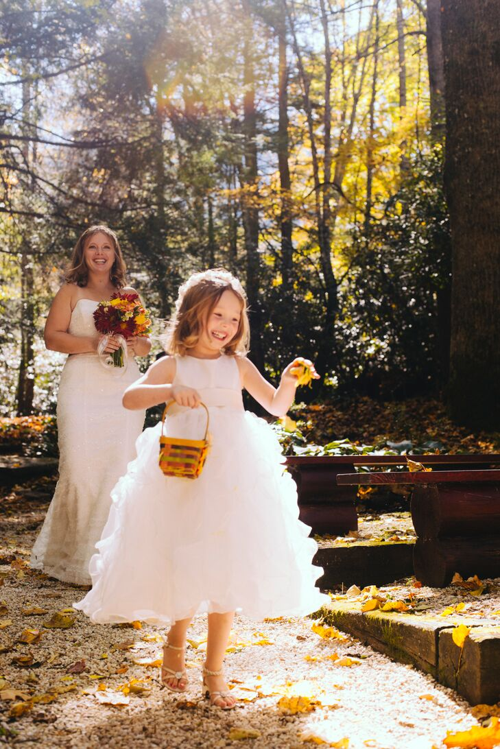 Sarah's daughter, Bailey, acted as flower girl for the elopement, leading her mother down the aisle in a playful, full-skirted dress with layers of floating ruffles.