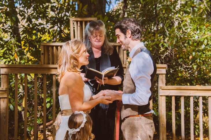 The couple chose to keep the decorations to a minimum, allowing the natural setting of Timberwolf Creek, to set the scene. The few decorations they incorporated into the day drew on the colors of the fall season and the ceremony's surroundings.