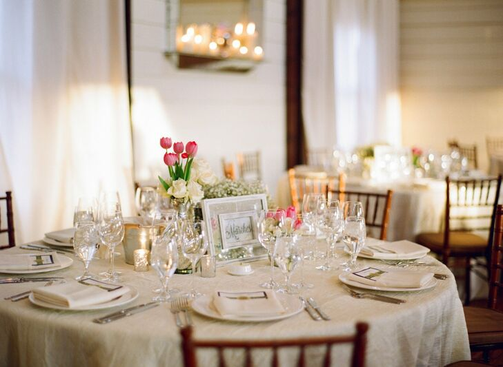 Small vases of pink tulips and white roses next to sparkly candle votives added a touch of romantic elegance to the table decor.