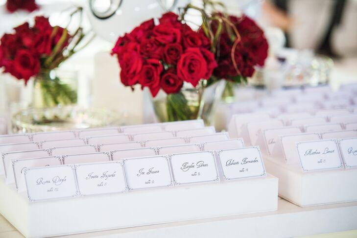 Pops of crimson added vibrancy to the reception's crisp white decor.