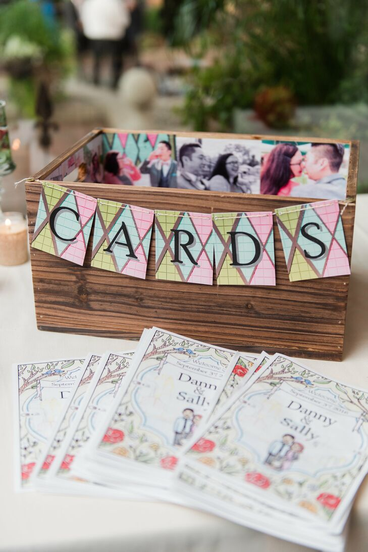 "Sally decorated a card box with photos of the couple and a colorful ""Cards"" sign."