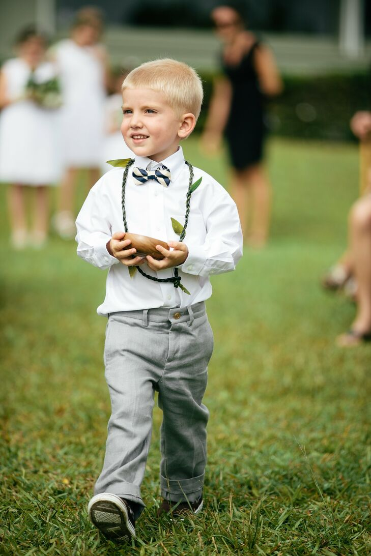 This young relative of the bride and groom carried the rings down the aisle in a gourd and accessorized with a traditional Hawaiian tea leaf lei.