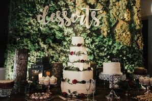 Elegant Dessert Table with Tiered Cake and Moss Backdrop