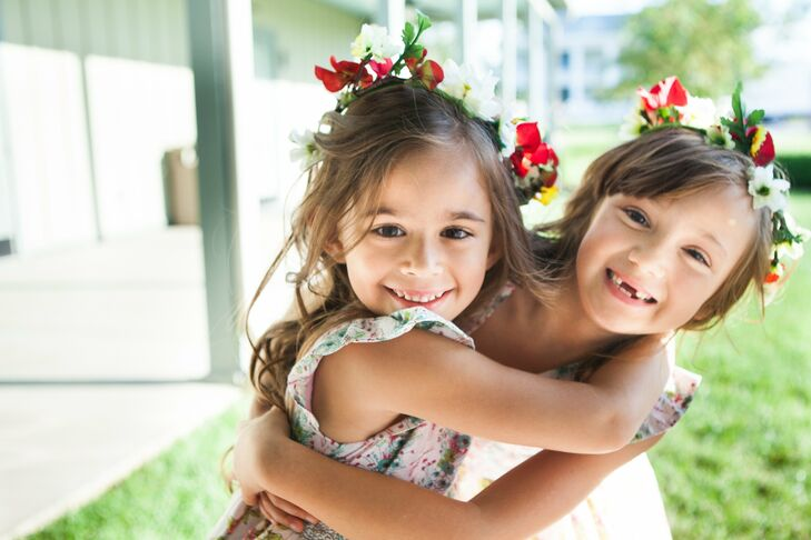 Printed sun dresses with ruffled cap sleeves paired with red and white floral crowns created a rustic, casual look for the flower girls.