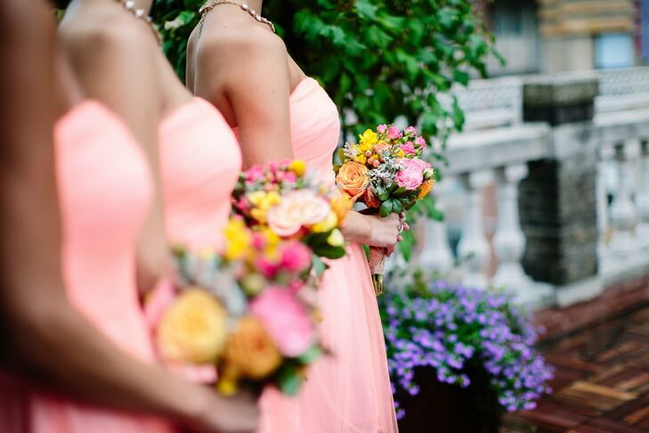 The bridesmaids carried bright bouquets of roses, garden roses, dahlias and protea.
