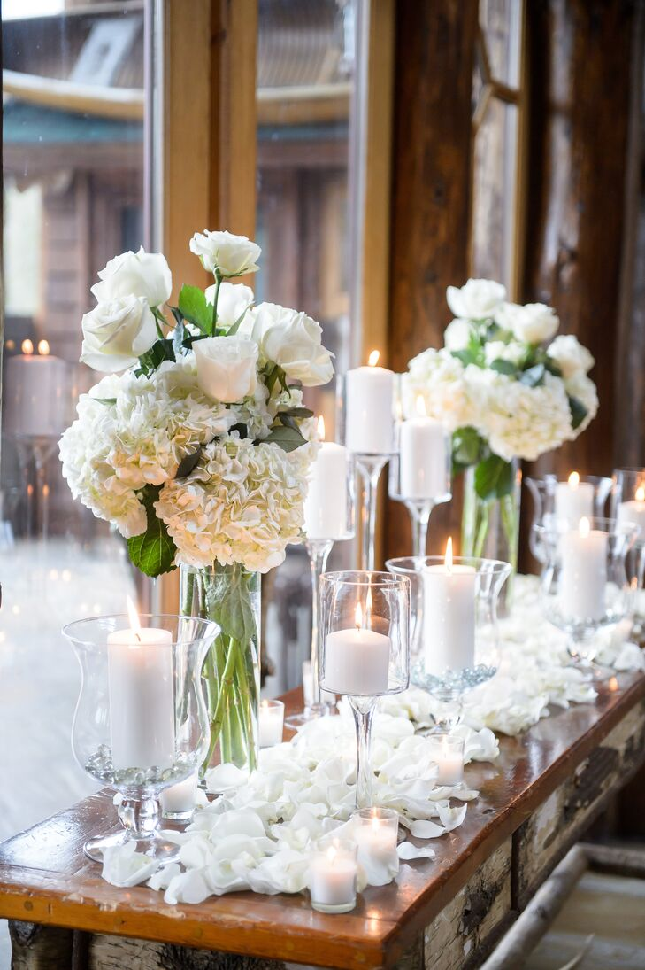 To achieve their winter wonderland theme, Erica and Janson called upon the expertise of Juniper Events and Trillium Florist. The pros infused the expansive event space at Whiteface Lodge with romantic winter flair with bountiful bouquets of snowy white roses and hydrangeas, rose petals and white pillar candles of varying sizes. As the sun set over the mountains, the decor created the illusion of freshly fallen snow.