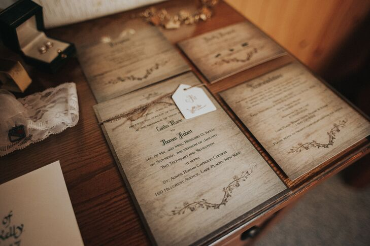 Cait and Tom's woodsy, rustic invitation suite gave the illusion of being carved on slabs of birch wood.