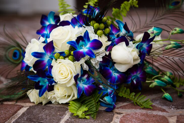 Alison carried a bouquet of white roses and dyed-blue orchids with greens.