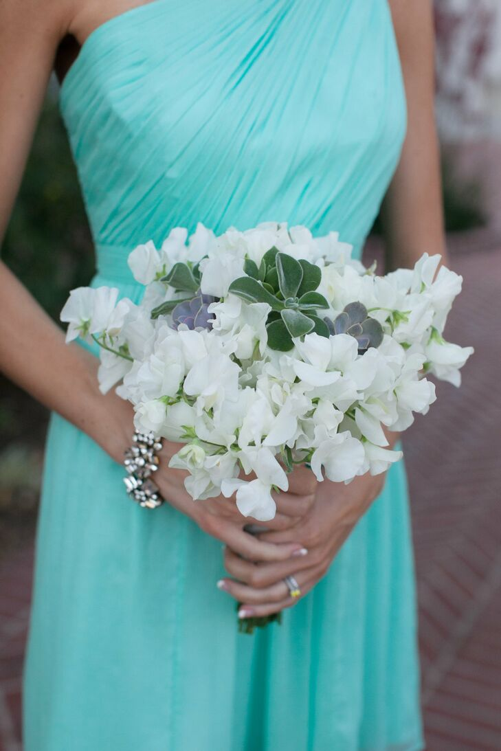White sweet peas were combined with succulents for a simple, yet striking bridesmaid bouquet.