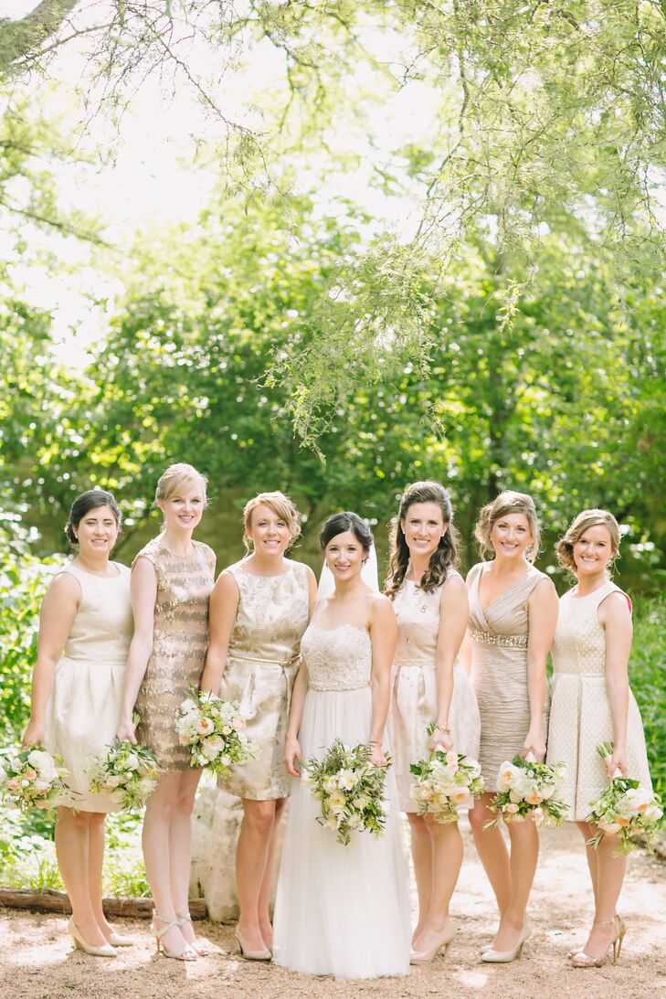 The bridesmaids wore gold and neutral dresses in different styles, complementing one another but retaining their individuality. They also carried bouquets similar to Kara's.
