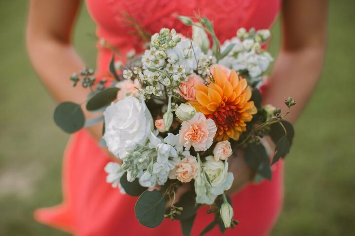 The bridesmaid bouquets featured a yellow dahlia surrounded by white and peach flowers.