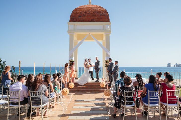 Maria and Maxwell got married in the Baja Norte Courtyard of the Riu Palace Resort Cabo San Lucas, overlooking the ocean and the arch of Cabo San Lucas, Mexico.