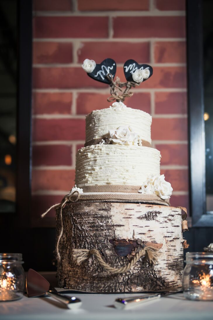 The couple opted for a small two tier chocolate cake with vanilla bean frosting made by a friend of Sarah's mother. It was embellished with burlap ribbon and displayed on a birch log cake stand.