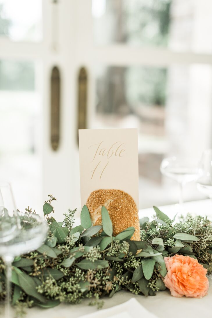 Gold detailing and handwritten calligraphy gave the reception table numbers a soft, elegant look.
