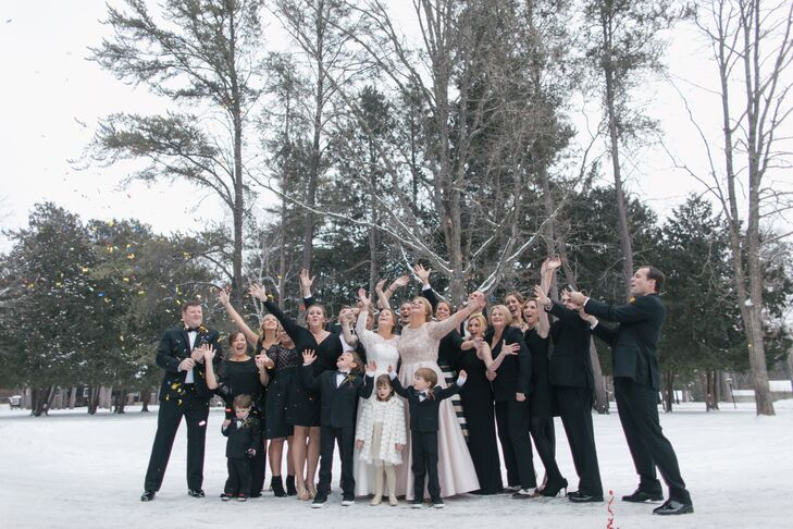 "The 16 people in the wedding party (11 women and 5 men) wore black. The men wore ""Black by Vera Wang"" tuxedos, black bow ties and black suspenders, paired with fun socks to reflect their personalities."