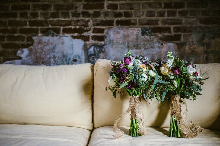 Deep purples, pale greens and burlap accents gave the textured bouquets a vintage touch. The bouquets included a mix of ranunculus, parrot tulips, button and micro poms, garden roses, hypernicum berries, bells of ireland, seeded eucalyptus, green trick and stock flowers.