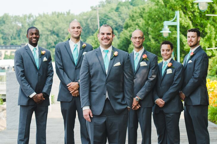 The groom and groomsmen wore gray Vera Wang suits with turquoise vests and ties.