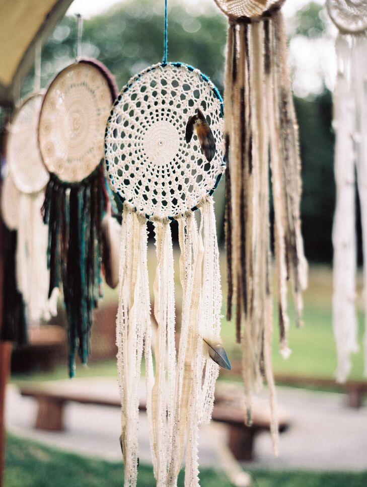 All the decor for the wedding was made by Jenna and Jon with the help of their friends and family members. Details such as macrame plant hangers, lace dream catchers and fringe-trimmed tablecloths gave the spacious open-air tent a decidedly bohemian feel.