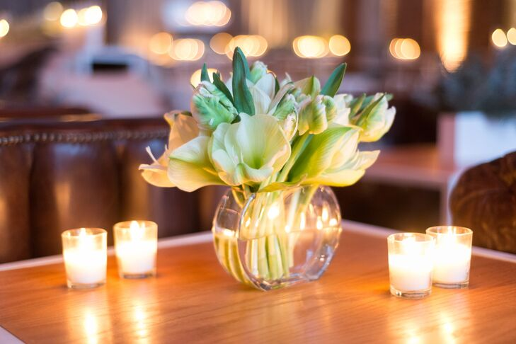 """Minimal accents, like small white votive candles and clear, low vases holding bunches of white parrot tulips, kept the space looking chic yet cozy. """"The whole look was modern, clean and very masculine,"""" Mike says. """"Not too froufrou or over-the-top."""""""