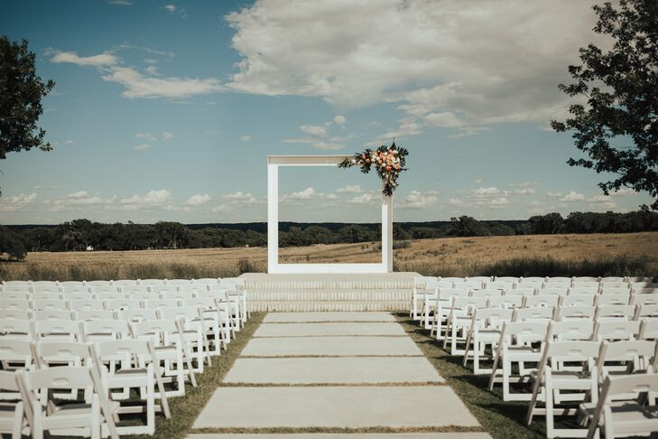The minimalistic décor of the outdoor ceremony brought attention to the property's expansive views.
