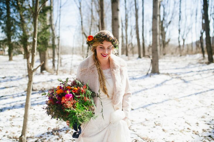 Going for a bohemian and natural look, Paula wore her long blonde hair in a fishtail braid, draping down her right shoulder. She wore a flower crown as well, made up of colorful berries and ranunculus.