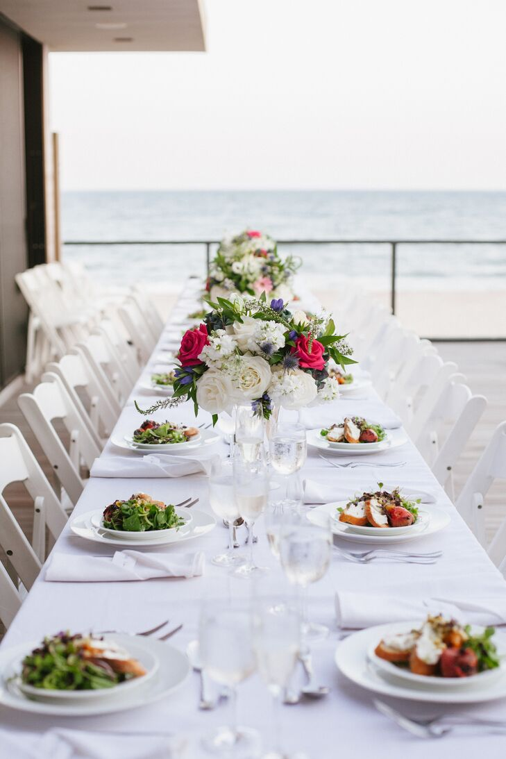 The couple's 24 guests sat around the swimming pool at the intimate, al fresco wedding reception.
