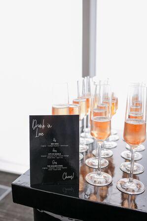 Champagne Display with Elegant Black Cocktail Menu Sign