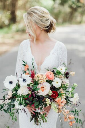 Elegant Bride with Lace V-Neck Gown, Updo and Overflowing Bouquet