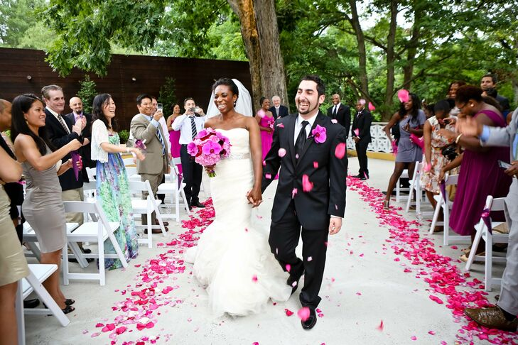 After being pronounced husband and wife, family and friends showered the bride and groom with rose petals.