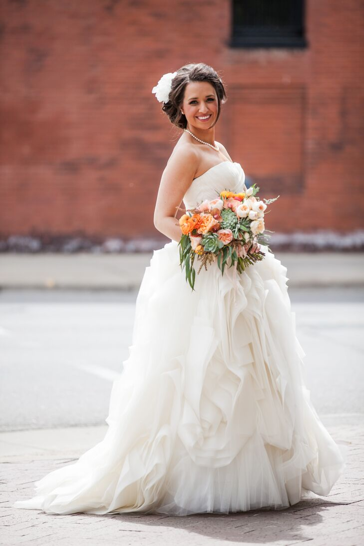 """""""I mean, seriously, does Vera do anything wrong?"""" Molly says. She immediately fell in love with this Vera Wang ball gown at L'Atelier in Minneapolis, Minnesota. She loved the organic feel with its funky ruffled skirt and ruched bodice. Even more, it fit her like a glove."""