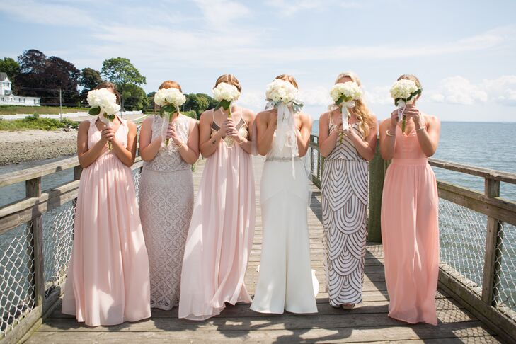 """""""It was most important to me that they feel comfortable and beautiful all day long,"""" Khrysty says of her bridesmaids. The special ladies chose their own dresses, shoes, and accessories in shades of off-white, pale peach and pink."""