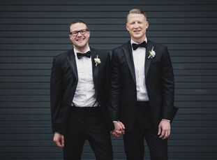 Dereck Flom (29 and works in supply chain) and Ryan Furlong (30 and works in communications) wanted their early summer wedding in Minneapolis to refle