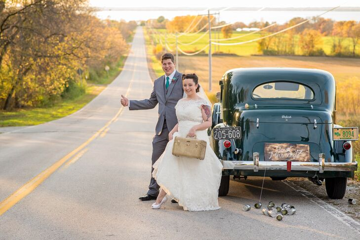 Inspired by a vintage aesthetic, Leah and Cody carried old suitcases for their wedding photos and found a driver with a 1930s Packard to transport them around town. They tied cans to the car for a classic wedding exit.