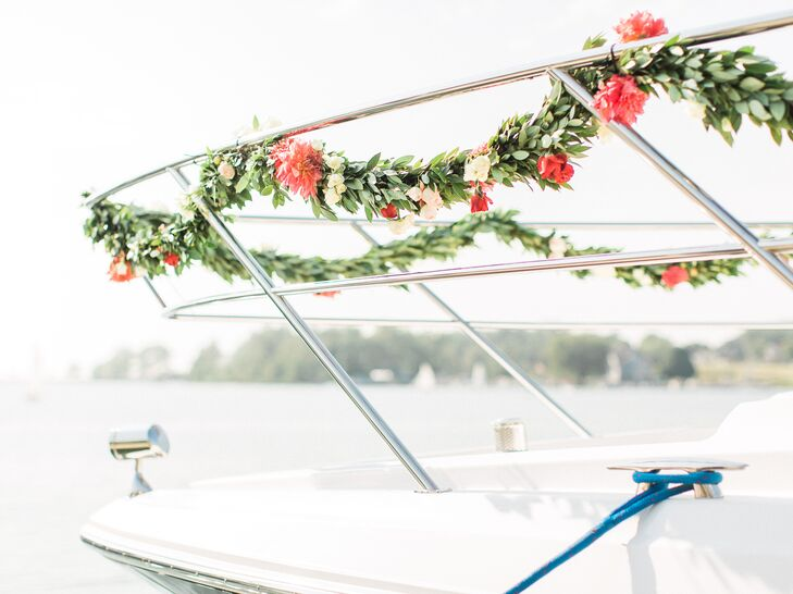 The newlyweds arrived to their venue via a boat adorned with a green and pink garland made from eucalyptus leaves.