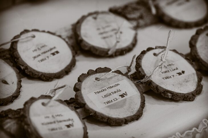 Jenny and Mark made wooden round escort cards for each guest.