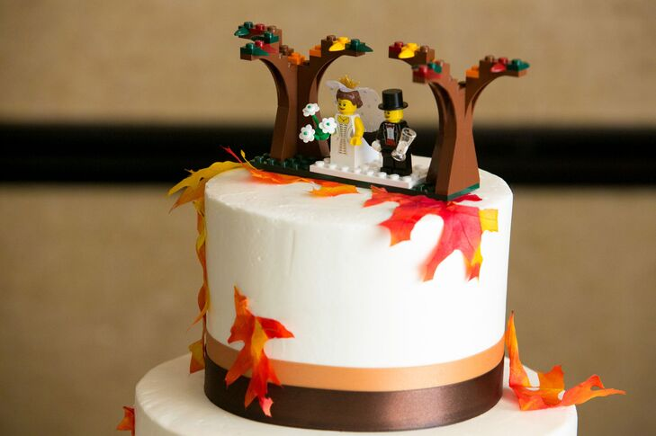 Jenny and Mark's wedding cake was topped with a Lego bride and groom and fall-inspired trees.