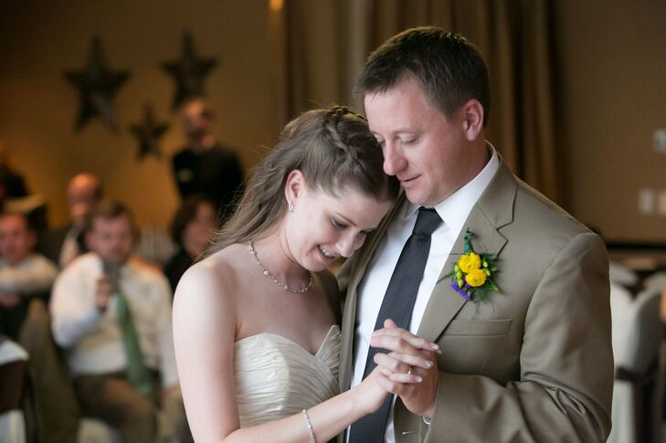 Mark wore a yellow dahlia and green hypericum berry boutonniere on his lapel.