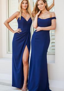 two bridesmaids in blue dresses