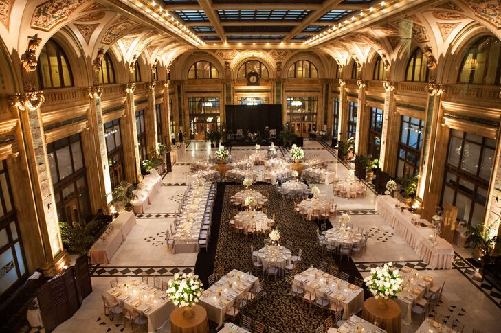Beneath the soaring arched ceiling of The Pennsylvanian, round and rectangular tables were arranged to break up the long, narrow space.