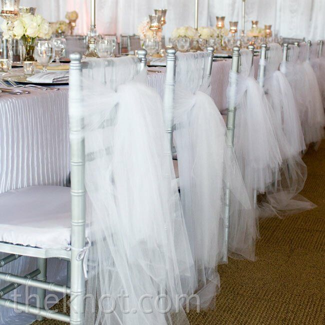 Silver chiavari chairs were covered with airy tulle.