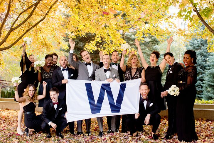 """Since the Cubs' victory parade was on the day of the wedding, it made sense to join the fun. """"Many of our favorite photos of that day were us out and about with parade-goers and the wedding party, having the time of our lives,"""" Michael says."""
