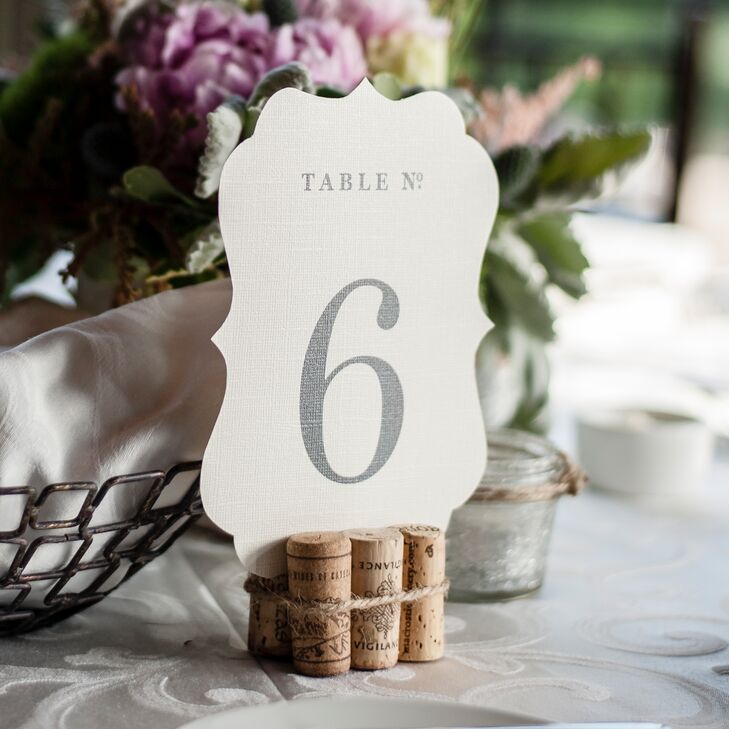 The table number cards were tucked into a DIY stand made of wine corks.