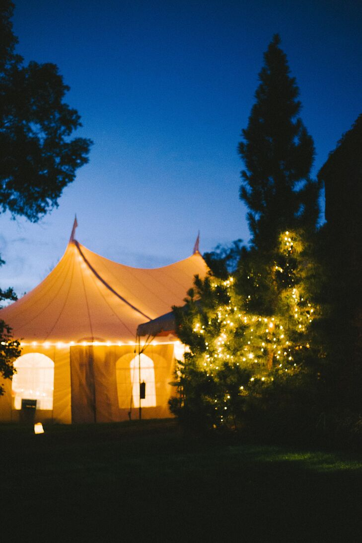 White Reception Tent Lit Up with String Lighting